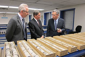 Natural Resources Minister Joe Oliver, right, and University of Calgary Vice-President of Research Ed McCauley (left) are briefed on rock core samples by Dr. Godfrey Nowlan, Acting Director Geological Surveys Canada.